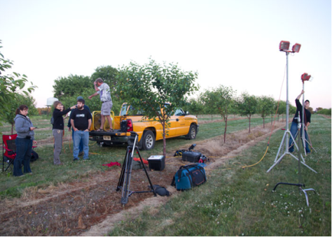 Setting up for night-filming to show how air induction nozzles on airblast sprayers can keep more product on target