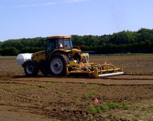 Broadcast application of metam-sodium fumigant showing rolling to seal the fumigant into the soil.