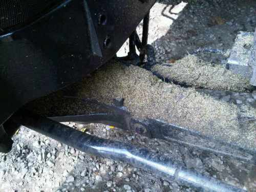 Pigweed seeds on axle of tractor